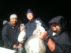 Anthony, Ross and Alan with full bags of squid steaks
