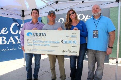 Costa presents a check to CCA