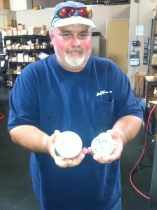 Jeff shows me a reel frame and the billet of aluminum it came from